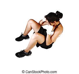 Girl doing sit-ups.