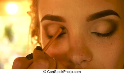 girl doing Smoky eyes close-up - young girl doing Smoky eyes...