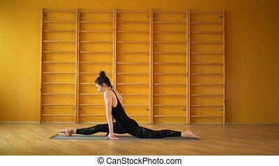 Girl doing split cross twine. Health lifestyle concept....