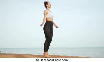 Girl doing sports on the beach