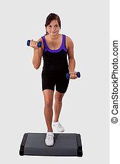 Girl doing step aerobics