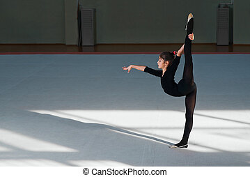 Girl doing the balance in  hall rhythmic gymnastics