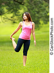 girl doing workout on grass
