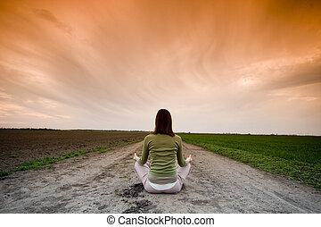yoga - Girl doing yoga against sunset