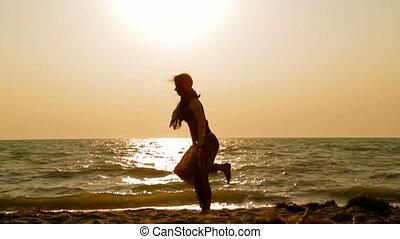 girl doing yoga exercises on the beach