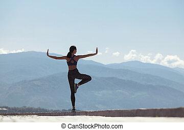 Girl doing yoga in the morning