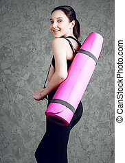 girl doing yoga - beautiful smiling teenage girl wearing...