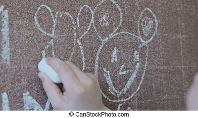 Girl drawing bee with chalk