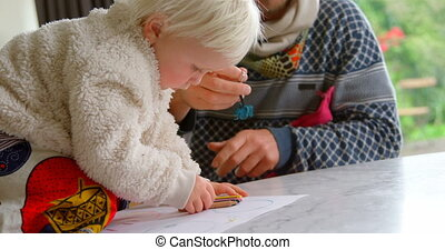 Girl drawing on paper at home 4k - Side view of Caucasian...