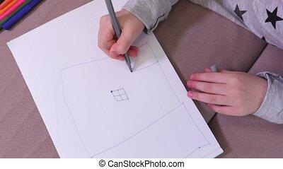 Girl drawing windows and door