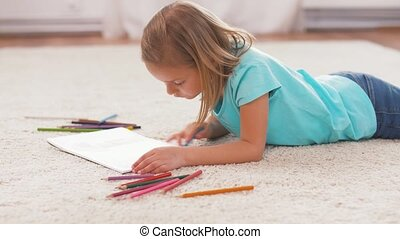 girl drawing with crayons in sketchbook at home - childhood,...