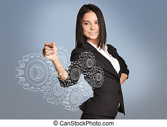 Girl draws a gear in the virtual space. team work concept