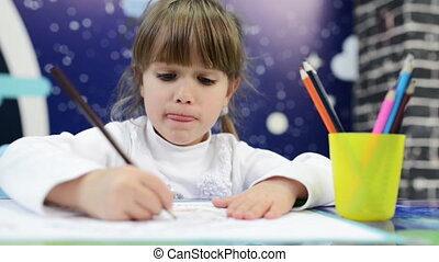 Girl draws emotions