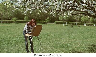 Girl draws on nature