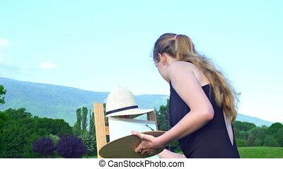 Girl draws on plein air city park mountain background - Girl...