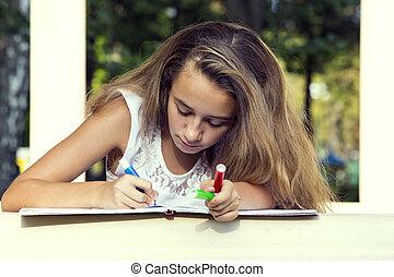 Girl draws on the album