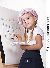 Girl draws on the easel