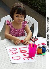 Girl draws paints