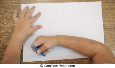 Girl draws with blue chalk for drawing makes an artistic...
