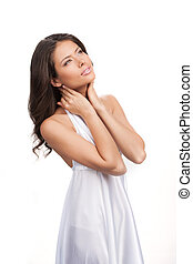 Girl dreaming. Thoughtful young woman in white dress looking away while standing isolated on white