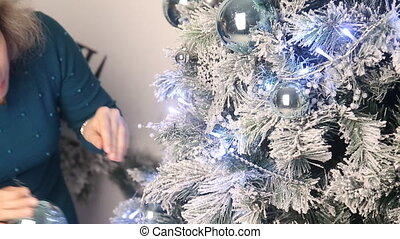 Girl dress up Christmas tree