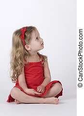 Girl Dressed in Red Looking Up