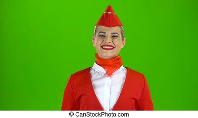 Girl dressed in red rejoices in victory. Green screen