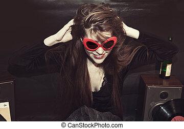 Girl dressed in sunglasses