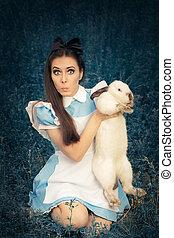 Girl Dressedas Alice in Wonderland - Portrait of a surprised...
