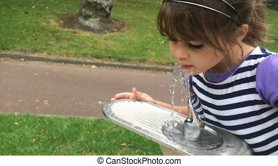 Girl drink water - Slow motion of a girl drink water from...