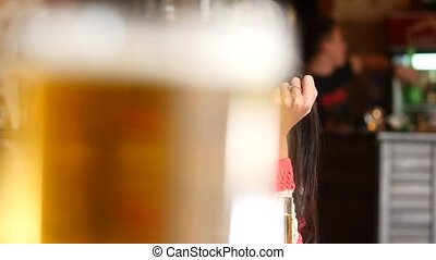 Girl drinking a beer in the bar