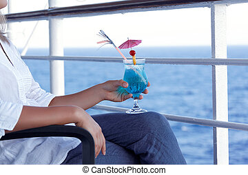 girl drinking a cocktail on a journey