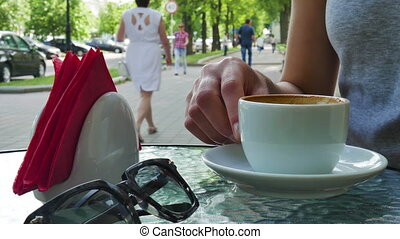 Girl drinking a cup of coffee on Cafe