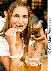 Girl drinking beer at Oktoberfest