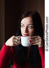Girl drinking coffe