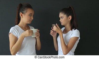 Girl drinking coffee in the studio