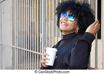 girl drinking coffee on the street