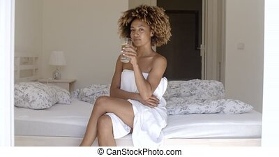 Girl Drinking Fresh Water On The Bed - Happy african...