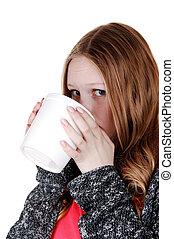 Girl drinking from big mug.