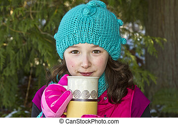 Girl drinking hot cocoa