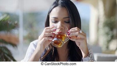 Girl Drinking Tea In Cafe
