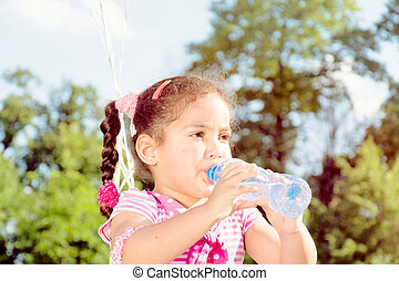 Girl drinking the water