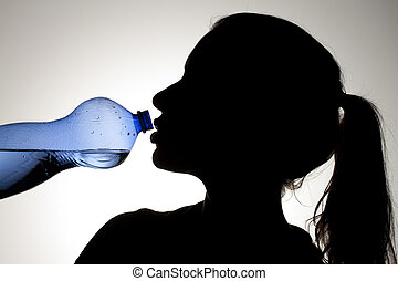 girl drinking water from blue bottle