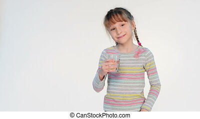 Girl drinking water - Portrait of girl drinking water and...