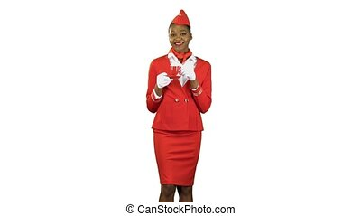 Girl drinks coffe her cap and flirts, she is a stewardess in a red suit. Alpha channel