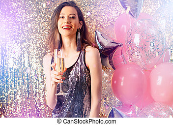 Girl drinks sparkling wine to celebrate the new year