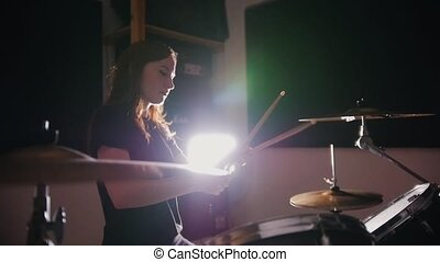 Girl drummer girl emotionally plays the drums