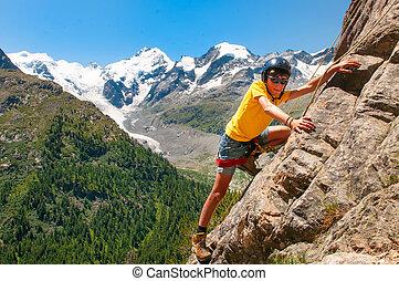 Girl during a climbing course in the high mountains