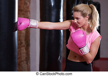 Girl during boxing at the gym