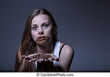 Girl during bulimic attack - Girl with eating disorder...